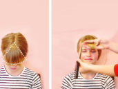 mother illustrating how to cut bangs on daughter