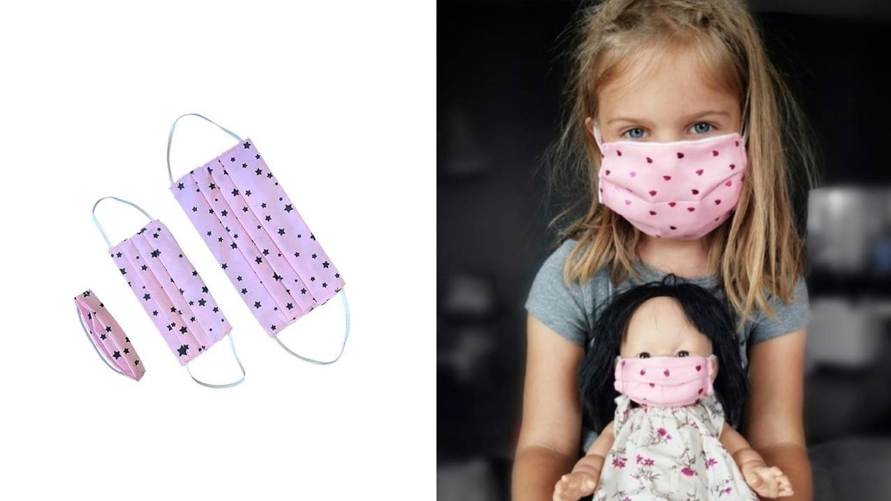 young girl and her doll wearing matching masks