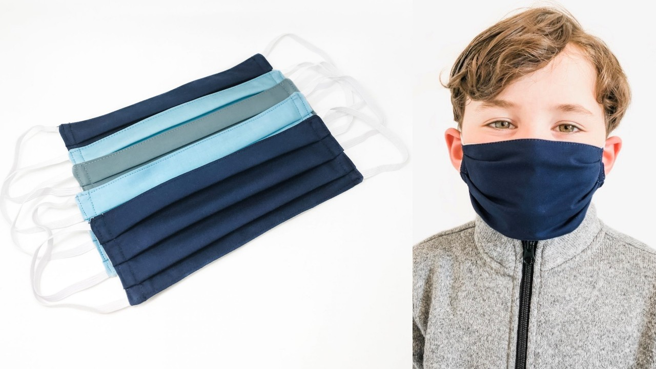young boy in pleated face mask