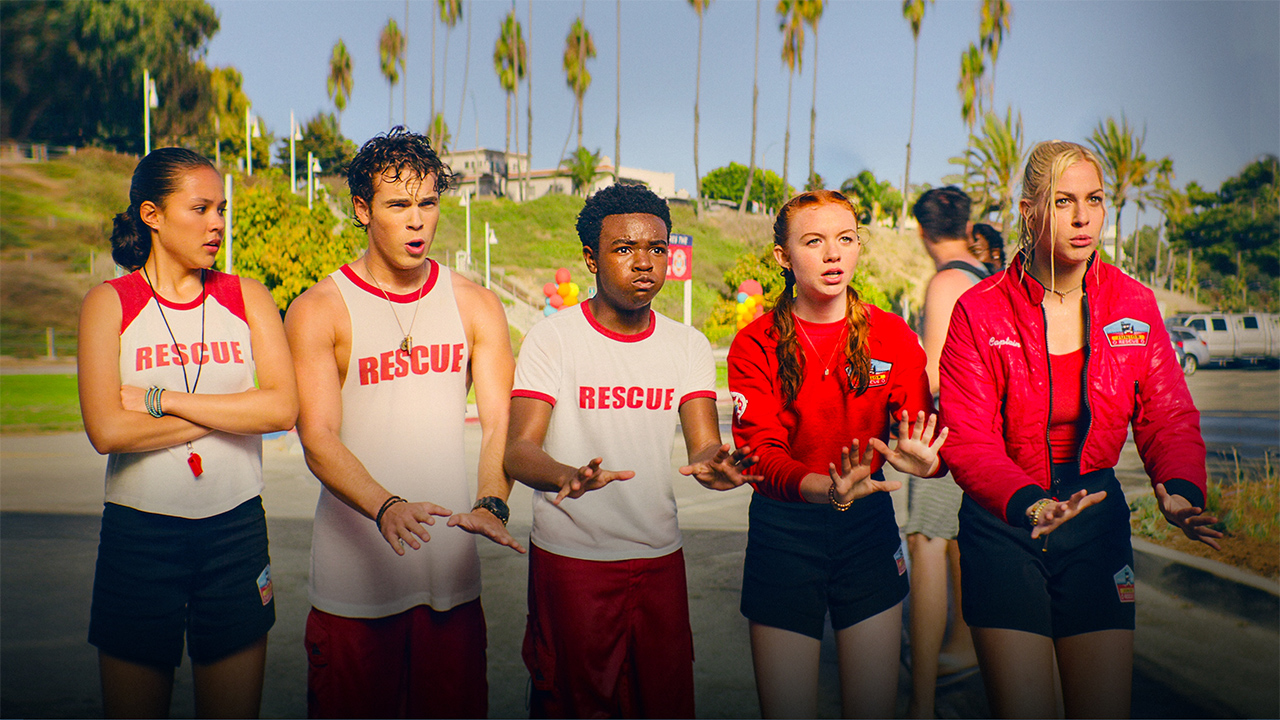 five teen lifeguards standing in a line