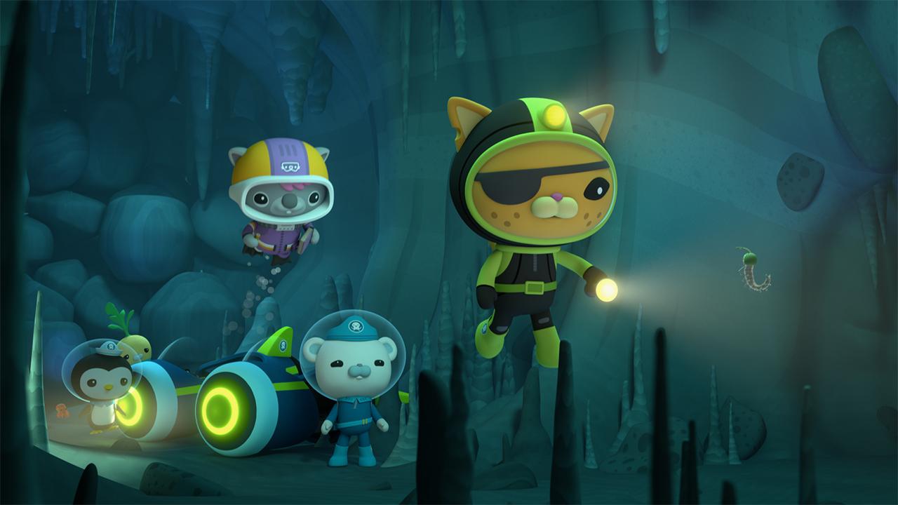 team of octonauts dive to explore an underwater cave