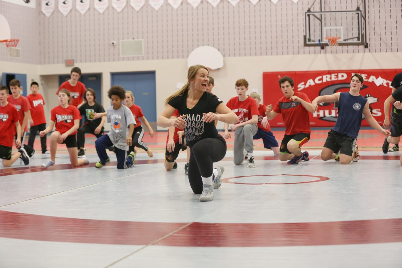 Erica Wiebe in a gym with a group of kids and youth