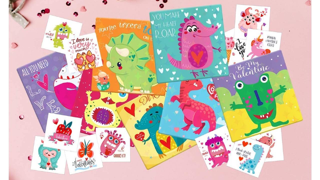 dinosaur valentine's day cards and temporary tattoos laid out on decorated table