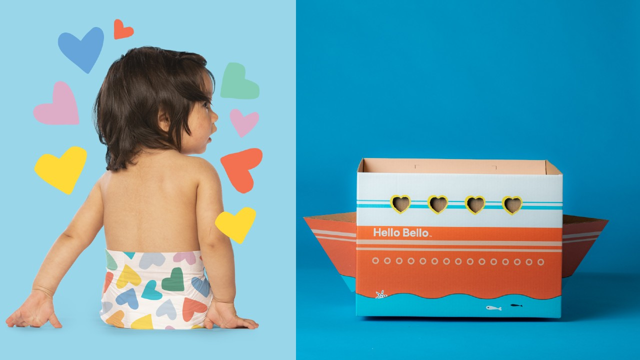 baby in heart print diapers and box shaped like boat with hearts