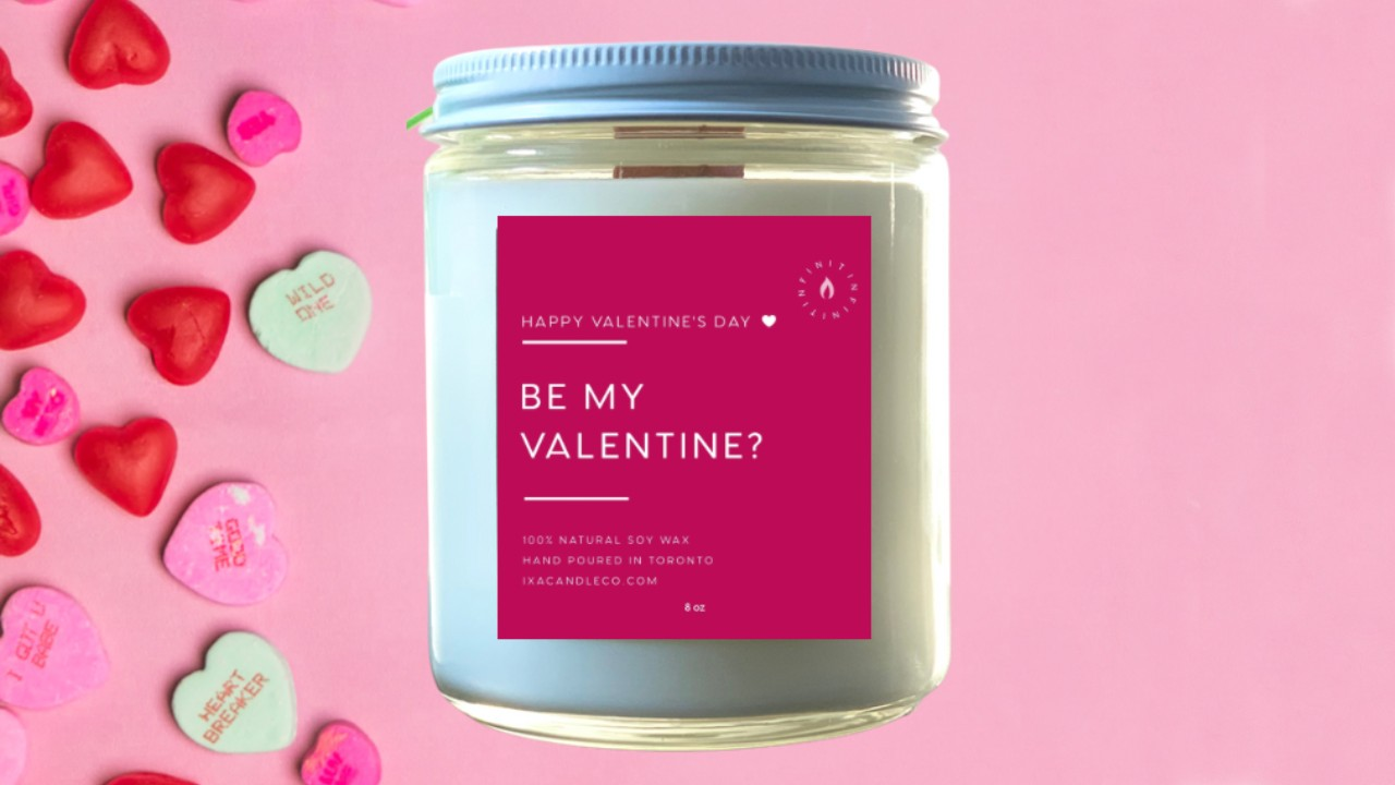 valentine's day candle on pink background