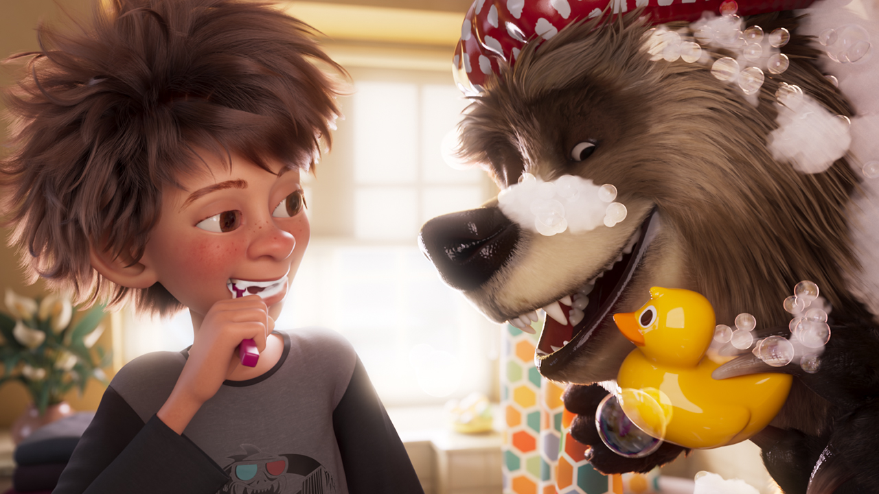 A still from Bigfoot Family showing an animated kid brushing his teeth while an animated bear shows off a rubber ducky while covered in bubble bath suds